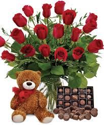 premium red roses with chocolates and bear ray hunter florist