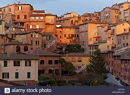 siena italy apartment houses in the old town stock photo