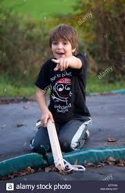 eight year boy child age 8 years portrait gun toys