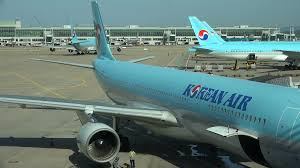 a korean air flight taxiing to the runway view of the wing tip