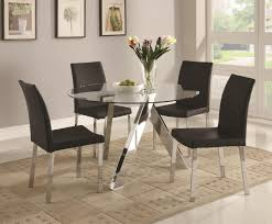 glass dining table on chrome base connected by black chairs