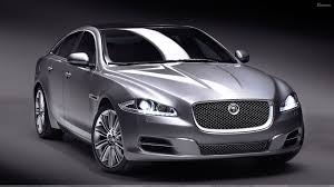jaguar front jaguar xj in grey n grey background front pose wallpaper