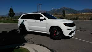 plasti dip jeep grand cherokee added front spoiler lip and carbon fiber roof debadged black out