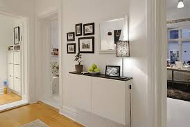How To Decorate Apartment Walls by Contemporary Apartment With White Walls And Rustic Furniture