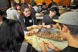 students volunteers prepare for thanksgiving at the berkshire
