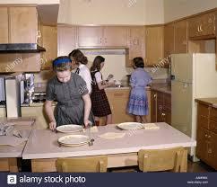 1960 1960s 4 girls in kitchen home economics class setting