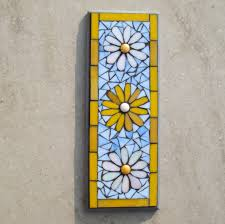 simple mosaic flower pattern wall plaque with white and yellow
