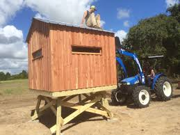 deer blinds gun bow blinds texas cedar modular here s an 8x8 blind with a gable roof on a 4 tower the guy in the bucket is my son brazos