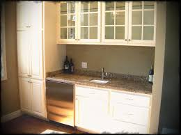 cherry cabinet doors for sale cherry wood cabinets with white granite counters and island