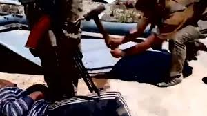 Russia Assad Deliver Blow To by Syrian Man Filmed Being Bludgeoned With Hammer Blows By U0027russian