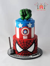 cool superhero birthday cake between the pages