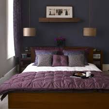 dark lavendar accent wall in street view bedroom with gray paint