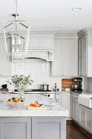 white kitchen cabinets with light grey backsplash 50 white herringbone backsplash tile in style white