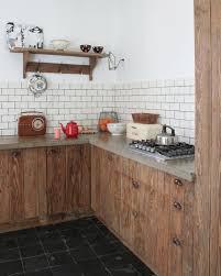 brick tile backsplash and barn wood kitchen cabinets in rustic kitchen