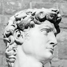 black and white profile of famous statue of david by michelangelo