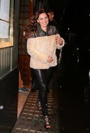 furry kelly brook wraps up warm in cream coat and tight leather