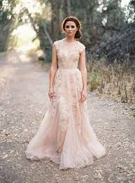 pink wedding dress picture of a sleeveless blush pink wedding dress with lace