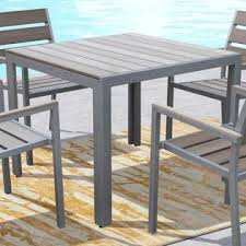 square outdoor dining table corliving gallant sun bleached grey square outdoor dining table
