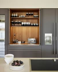walnut veneer interior of the bulthaup pocket door with soft