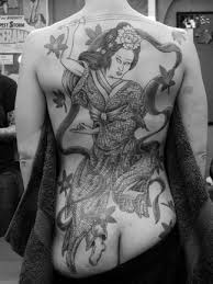 female tattoos designs quotes on side of ribs on back on