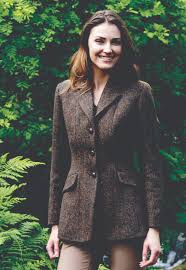 a classic harris tweed jacket with two back vents and a feminine