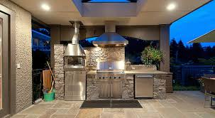awesome outdoor kitchen design in terrace with stone backsplash