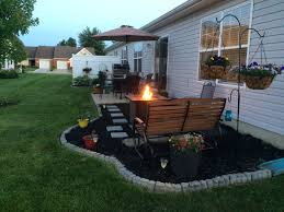 low cost patio extension using mulch paver steps and concrete