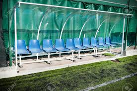 coach and reserve benches in a soccer field stock photo picture