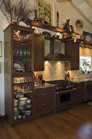 ideas for tops of kitchen cabinets how to decorate the top of a cabinet and how not to designed
