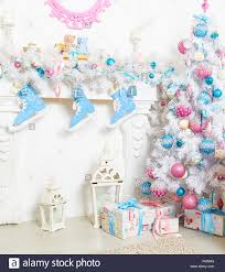 white garland above the fireplace with blue skates and toys stock