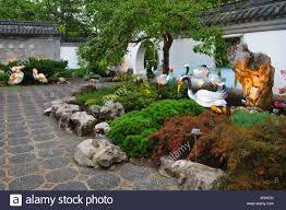 garden ornaments along a walkway in the garden at