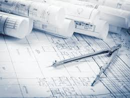 and house plans rolls of architecture blueprints and house plans on the table