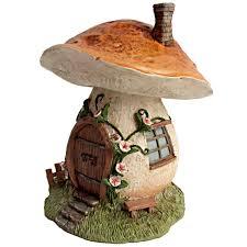 miniature mushroom house with flowers miniature fairy gardens