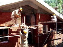 building a house free picture building house building construction workers