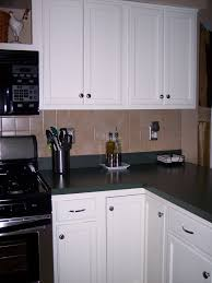 White Laminate Kitchen Cabinets Remodelaholic Painting Kitchen Cabinets Check