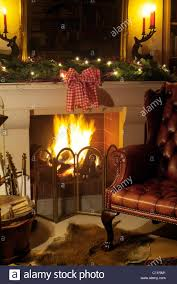 leather chair fireplace stock photos u0026 leather chair fireplace