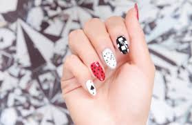this alice in wonderland nail art is whimsical and wonderful