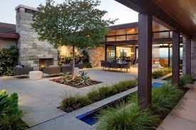 outdoor courtyard pockets of water in the concrete courtyard floor break up the