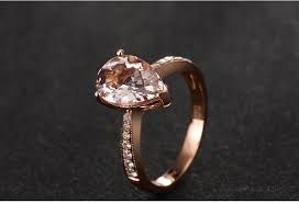 morganite pear engagement ring 1 50 carat morganite and halo engagement ring in gold