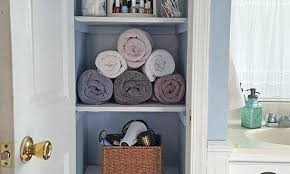 bathroom linen closet ideas bathroom closet ideas toilet paper basket now a pretty linen