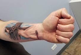 attractive jesus wrist tattoos design