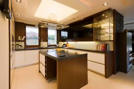 kitchen room brown wooden kitchen island black countertop infrared