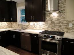 attractive subway backsplash tile and high end black kitchen