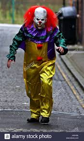 Killer Clown Costume Posed By Model A Person Wearing A Clown Costume In A Street In