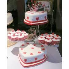 heart wedding cake heart shaped and white wedding cake with cupcake sides