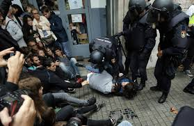 hundreds injured as spanish police clash with defiant voters in
