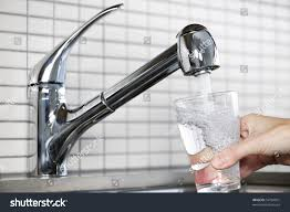 kitchen drinking water faucet filling glass water stainless steel kitchen stock photo 54784891