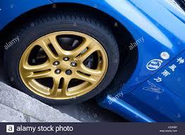 subaru blue subaru blue body with gold wheel trims stock photo royalty free