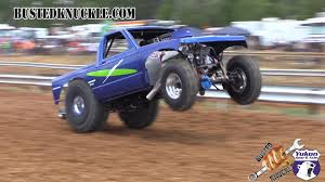 monster trucks racing in mud mud drag racing outlaws busted knuckle films
