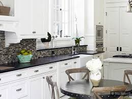 white glass subway tile kitchen backsplash damaged cabinets